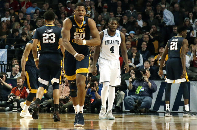 West Virginia's Sagaba Konate celebrates a made basket against Villanova during the second half of an NCAA men's college basketball tournament regional semifinal Friday, March 23, 2018, in Boston. (AP Photo/Mary Schwalm)