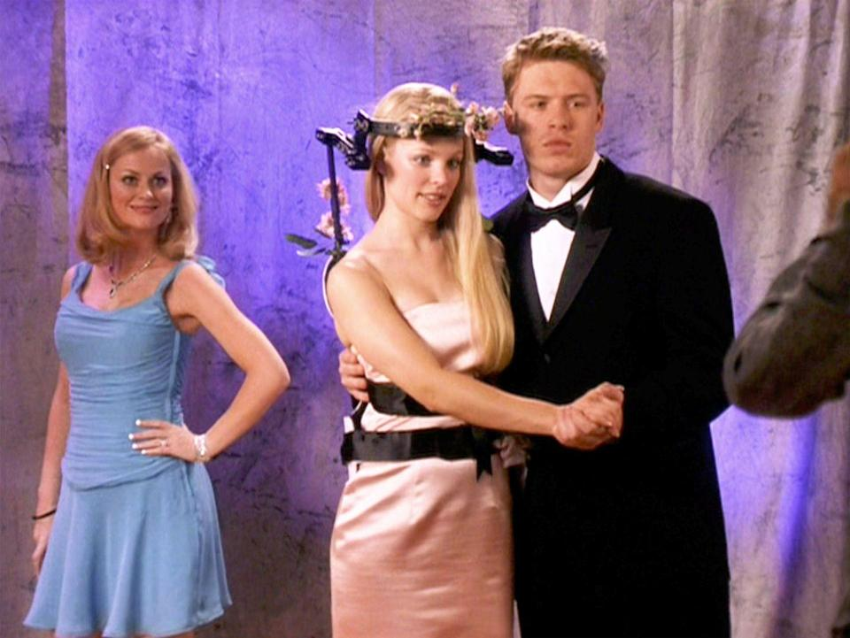 """<p>Not even getting hit by a school bus could keep Regina George from the school dance. Some pink flowers on her back brace and an attention-grabbing strapless satin pink mini dress did the trick.</p><p><a class=""""link rapid-noclick-resp"""" href=""""https://www.amazon.com/Mean-Girls-Lindsay-Lohan/dp/B000HZGBJC?tag=syn-yahoo-20&ascsubtag=%5Bartid%7C10063.g.36197518%5Bsrc%7Cyahoo-us"""" rel=""""nofollow noopener"""" target=""""_blank"""" data-ylk=""""slk:STREAM NOW"""">STREAM NOW</a></p>"""