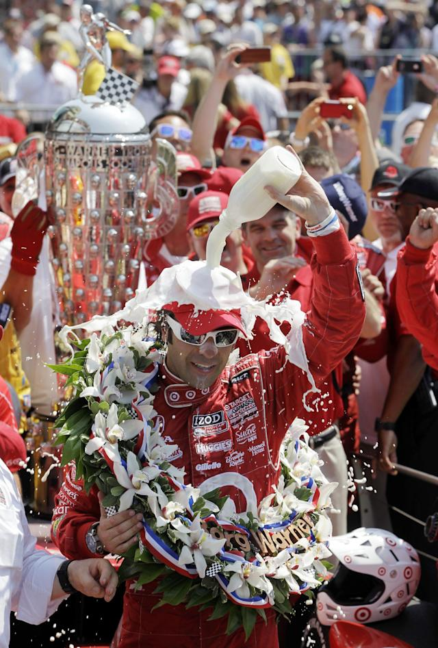 FILE - In this May 27 2013, file photo, Dario Franchitti, of Scotland, celebrates in Victory Lane after winning IndyCar's Indianapolis 500 auto race at Indianapolis Motor Speedway in Indianapolis. The three-time Indianapolis 500 winner said Thursday, Nov. 14, 2013, that doctors have told him he can no longer race because of injuries sustained in an IndyCar crash last month. He fractured his spine, broke his right ankle and suffered a concussion in the Oct. 6 crash at Houston. (AP Photo/Darron Cummings, File)