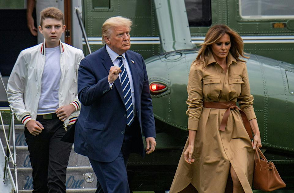 US President Donald Trump returns to the White House with First Lady Melania Trump (R) and their son Baron (L) after a weekend in Bedminster on August 16, 2020 in Washington, DC. (Photo by Eric BARADAT / AFP) (Photo by ERIC BARADAT/AFP via Getty Images)
