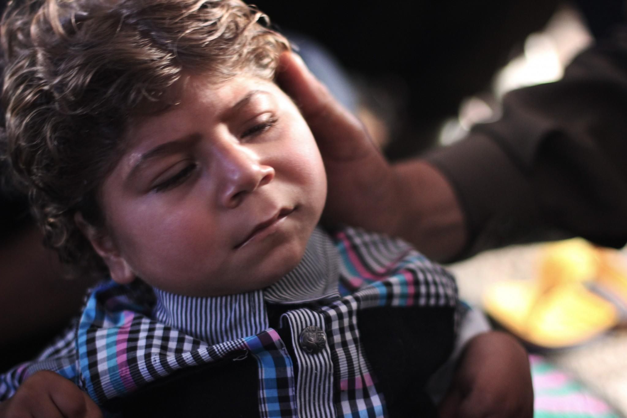 An internally displaced boy with brain damage hasn't had medical attention in weeks