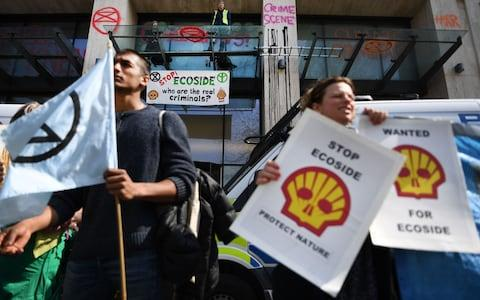 Protesters outside the Shell headquarters in London - Credit: Andy Rain/REX