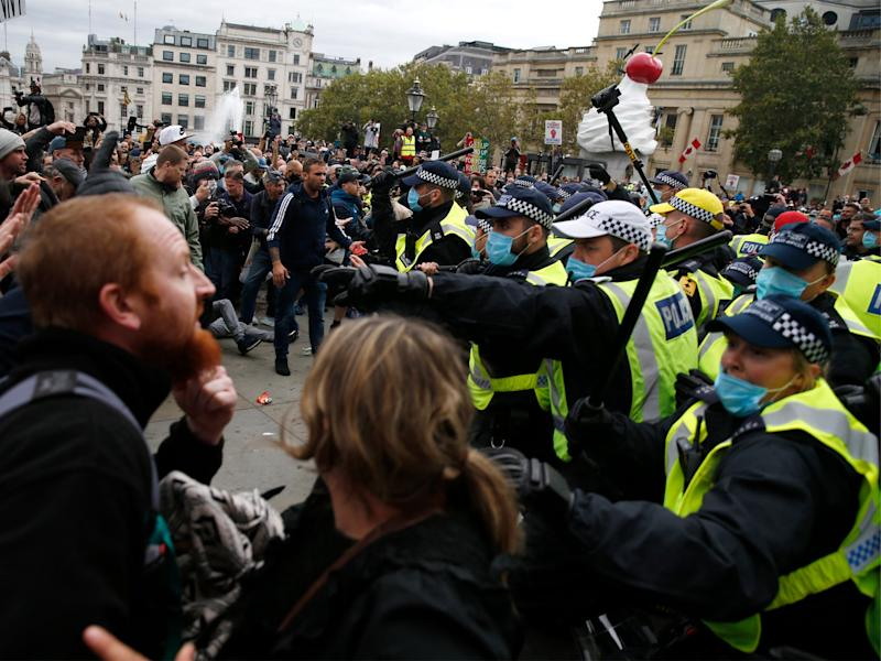 Police and protestors clash in Trafalgar Square as demonstrators are ordered to vacate (Hollie Adams/Getty Images)