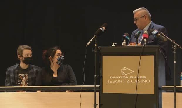 Federation of Sovereign Indigenous Nations Vice-Chief David Pratt, right, addresses Annette Custer and her partner during a press conference Tuesday at the Dakota Dunes Resort Hotel in Saskatoon.