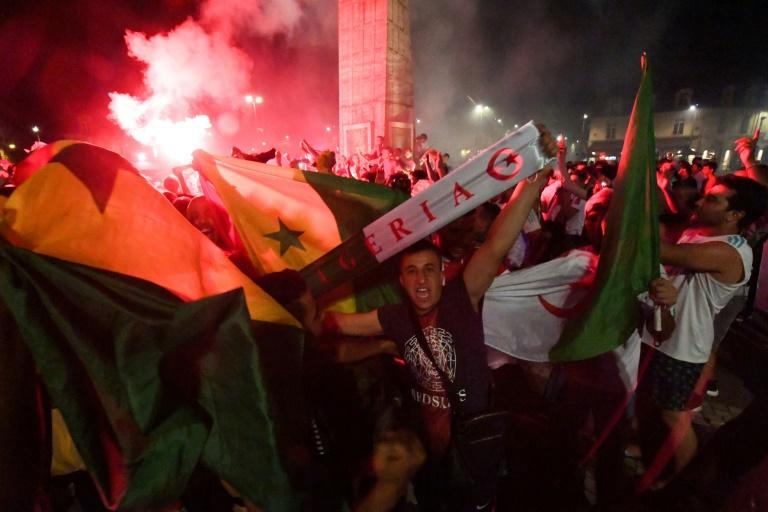Riotous celebrations erupted around France after the Algerian football team qualified for the final of the Africa Cup of Nations (AFP Photo/MEHDI FEDOUACH)