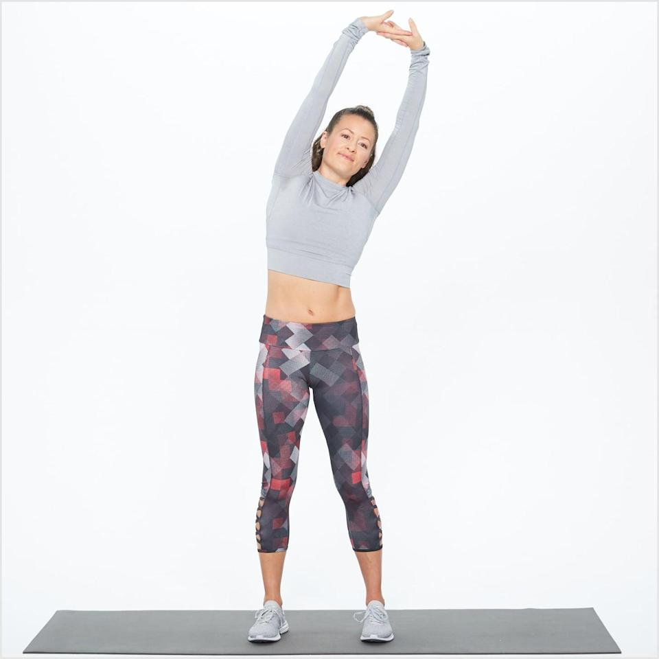 "<p>A simple side bend helps to stretch all the muscles in your side, targeting the lats in your back, the muscles in your ribs, and your outer hip and leg muscles, said Chad Walding, DPT, physical therapist and co-founder of <a href=""https://www.nativepath.com/"" class=""link rapid-noclick-resp"" rel=""nofollow noopener"" target=""_blank"" data-ylk=""slk:NativePath"">NativePath</a>. Your side muscles are getting a workout when you walk, so you want to make sure they're warm and loose first.</p> <ul> <li>Stand with your feet hips-width apart and core pulled toward your spine. Lift both hands over your head and interlace your fingers with your palms toward the ceiling.</li> <li>Inhale, straightening your spine toward the ceiling.</li> <li>Keep that length as you exhale and lean to the left, making sure your hips and chest stay facing forward. Keep your core tight as you lean over.</li> <li>Gently pulse your arms back toward the center and the ceiling, increasing the stretch in your right side. Repeat the pulse a couple times.</li> <li>Inhale as you straighten and return to the starting position.</li> <li>Switch sides and repeat.</li> </ul>"