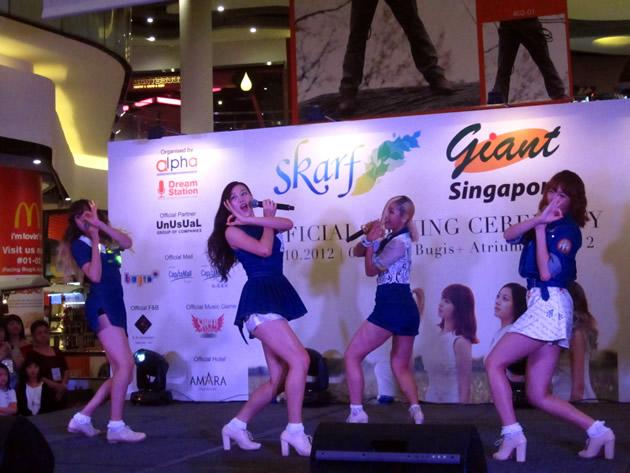 "SKarf performs their signature ""Oh! Dance"" song for a crowd of more than 500 fans gathered at Bugis+. (Yahoo! photo)"