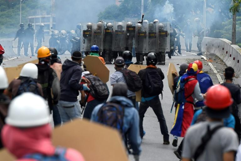 Opposition activists clash with riot police during a protest against Venezuelan President Nicolas Maduro, in Caracas on May 3, 2017