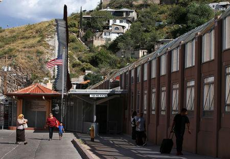 Pedestrians make their way into the the United States from Mexico at the pedestrian border in Nogales, Arizona, United States, October 9, 2016. REUTERS/Mike Blake