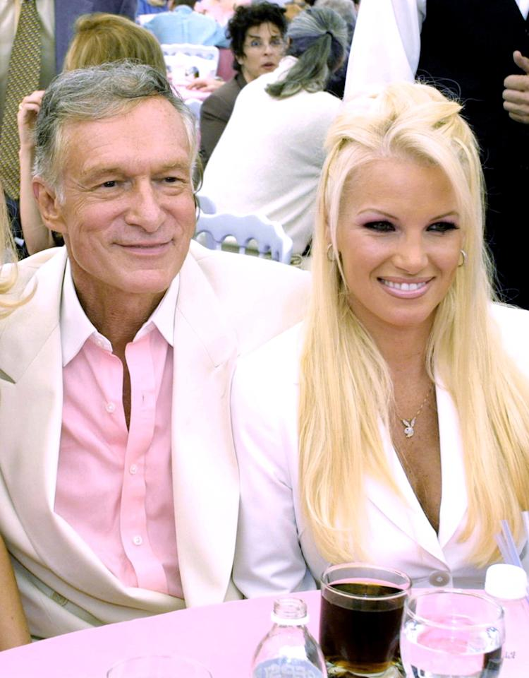 388383 11: Playboy Playmate Of The Year Brande Roderick, left, Playboy founder Hugh Hefner and his girlfriend Tina Jordon sit together at the Playmate of The Year Party at The Playboy Mansion April 26, 2001 in Los Angeles, CA. (Photo by Brad Elterman/Newsmakers)