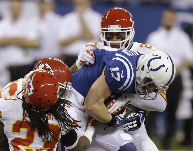Indianapolis Colts' Griff Whalen (17) is tackled by a group Kansas City Chiefs defensive players during the first half of an NFL wild-card playoff football game Saturday, Jan. 4, 2014, in Indianapolis. (AP Photo/Michael Conroy)