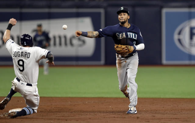 Seattle Mariners shortstop J.P. Crawford (3) forces out Tampa Bay Rays' Eric Sogard (9) at second base on a fielder's choice by Kevin Kiermaier during the second inning of a baseball game Monday, Aug. 19, 2019, in St. Petersburg, Fla. (AP Photo/Chris O'Meara)