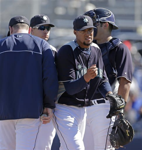 Seattle Mariners starting pitcher Hector Noesi comes out of the game in the first inning after giving up six runs in an exhibition spring training baseball game against the San Diego Padres Friday, Feb. 22, 2013, in Peoria, Ariz. (AP Photo/Charlie Riedel)