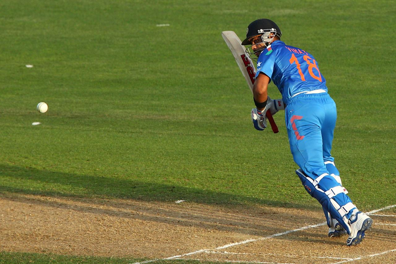 NAPIER, NEW ZEALAND - JANUARY 19:  Virat Kohli of India bats during the first One Day International match between New Zealand and India at McLean Park on January 19, 2014 in Napier, New Zealand.  (Photo by Hagen Hopkins/Getty Images)