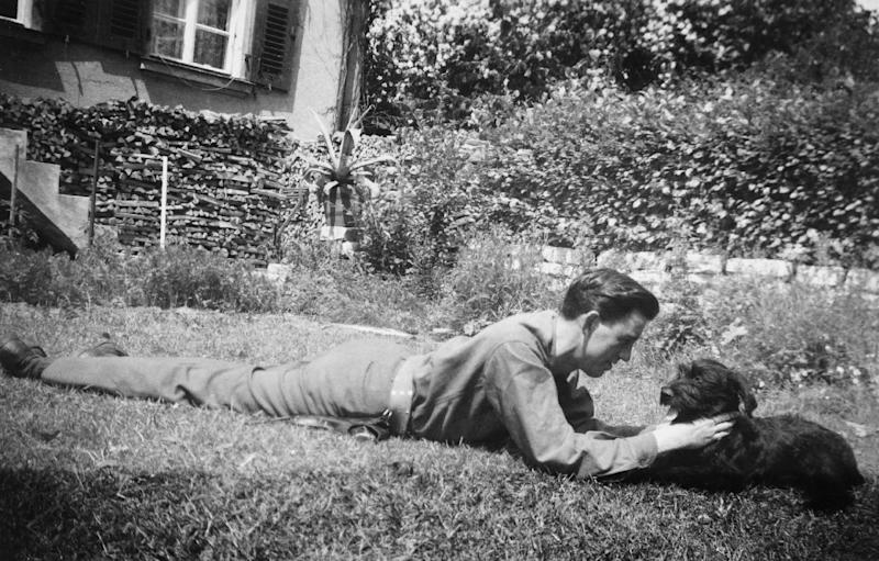 """In this undated image provided by The Story Factory, """"Catcher in the Rye"""" author, J.D. Salinger plays with his dog, Benny. Shane Salerno, a screenwriter, has taken on a surprising and news-making identity: the latest, and, apparently, greatest seeker of clues about J.D. Salinger. (AP Photo/The Story Factory, Paul Fitzgerald)"""