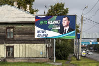 """An election poster with a portrait of Mikhail Degtyaryov, a member of the nationalist Liberal Democratic Party and saying """"Actions are more important than words,"""" is displayed in the Russian city of Khabarovsk in the country's Far East, Thursday, Sept. 9, 2021. Degtyaryov is on the ballot for governor in the three days of regional voting that concludes Sunday, Sept. 19, 2021. (AP Photo/Igor Volkov)"""