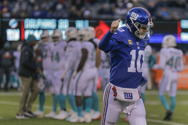 New York Giants quarterback Eli Manning (10) runs off the field during the fourth quarter of an NFL football game against the Miami Dolphins, Sunday, Dec. 15, 2019, in East Rutherford, N.J. (AP Photo/Seth Wenig)