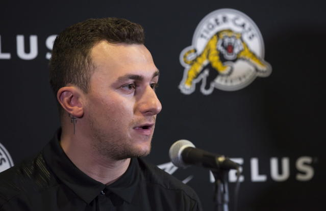 Former NFL quarterback and Heisman Trophy winner Johnny Manziel speaks at CFL press conference, Saturday, May 19, 2018, in Hamilton, Ontario, after announcing that he has signed a two-year contract to play for the Hamilton Tiger-Cats. (Aaron Lynett/The Canadian Press via AP)