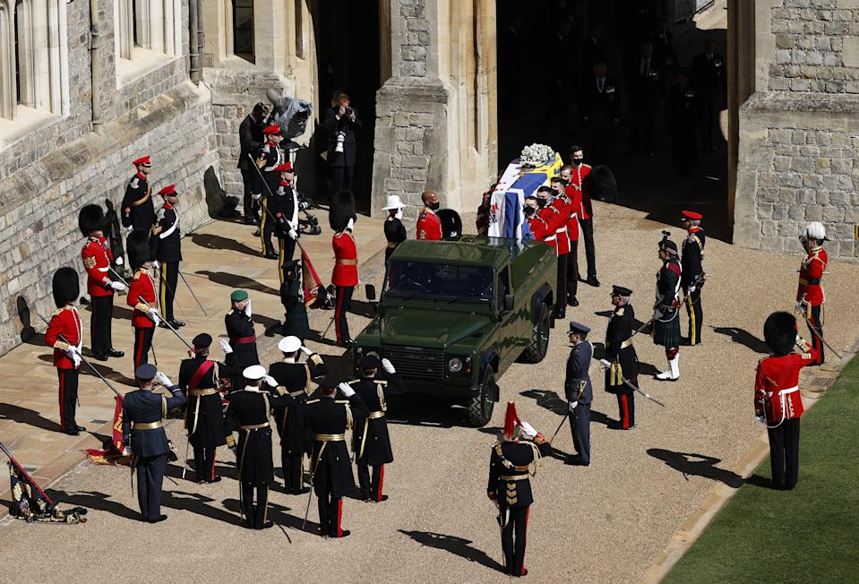 <p>The Duke of Edinburgh's coffin, covered with Personal Standard, was carried to the funeral at St George's Chapel on a purpose-built Land Rover Defender. (PA)</p>