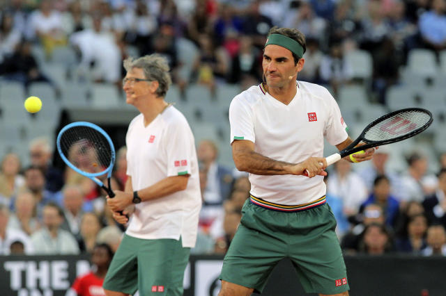 Roger Federer and Bill Gates take on Rafael Nadal and Trevor Noah in the exhibition match held at the Cape Town Stadium in Cape Town, South Africa, Friday Feb. 7, 2020. (AP Photo/Halden Krog)