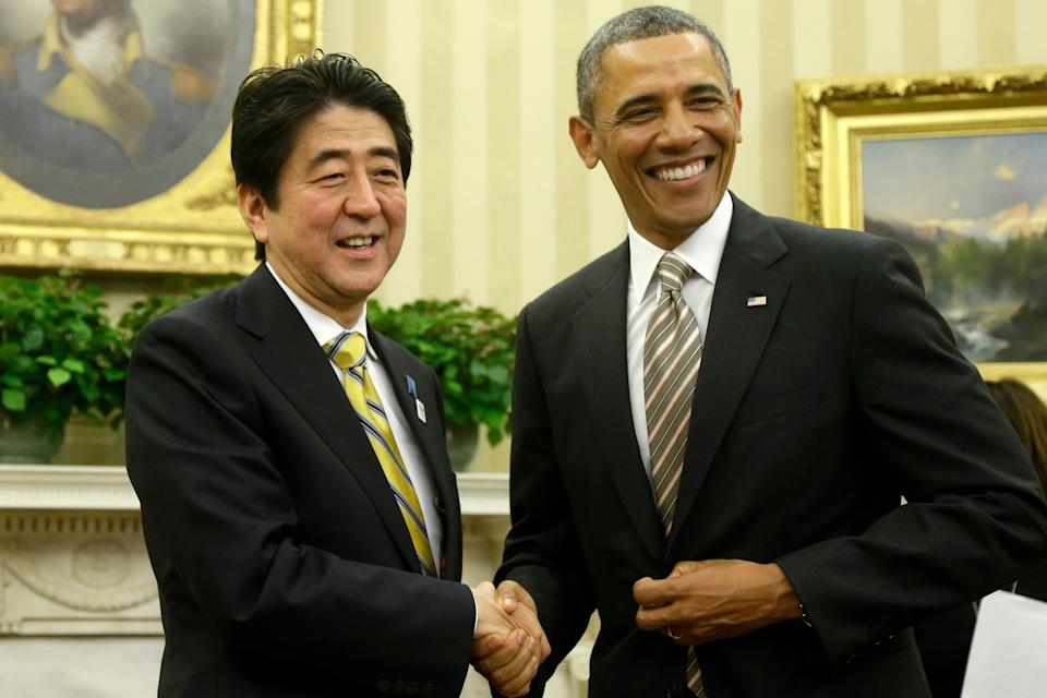 President Barack Obama shakes hands with Japan's Prime Minister Shinzo Abe in the Oval Office of the White House in Washington, Friday, Feb. 22, 2013.