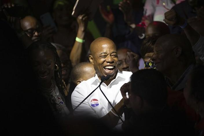 Mayoral candidate Eric Adams mingles with supporters during his election night party, late Tuesday, June 22, 2021, in New York. (AP Photo/Kevin Hagen)