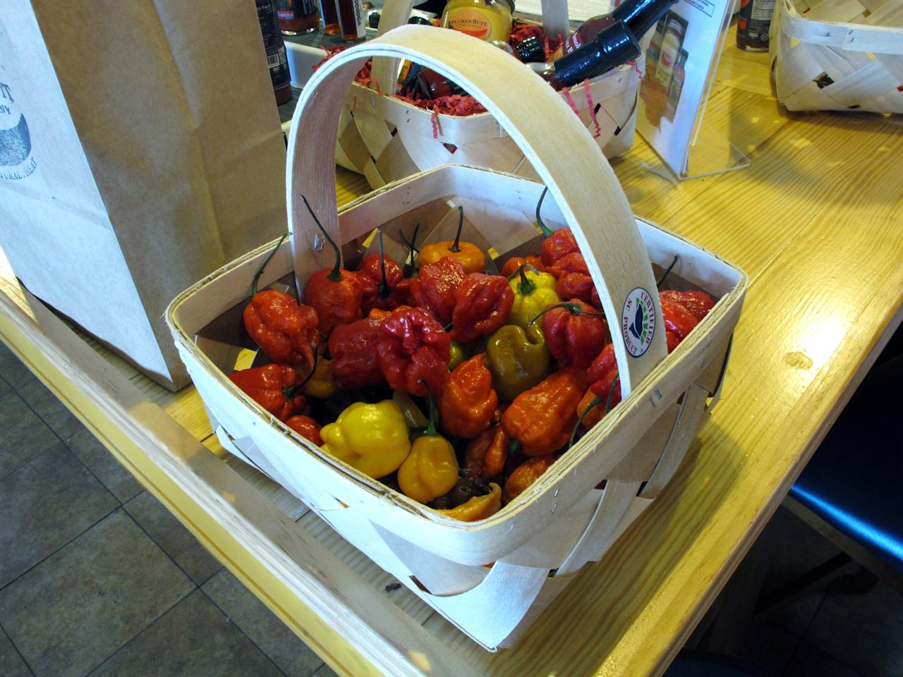 This Dec. 12, 2013 photo shows Carolina Reaper peppers at Ed Currie's store in Fort Mill, S.C. Last month, the Guinness Book of World Records decided Currie's peppers were the hottest on Earth, ending a more than four-year drive to prove no one grows a more scorching chili. (AP Photo/Jeffrey Collins)