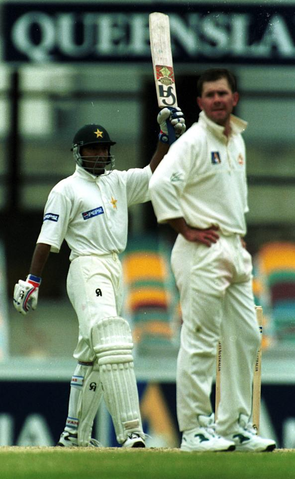 8 Nov 1999:  Saeed Anwar of Pakistan celebrates his century during his innings of 118 not out as Ricky Ponting of Australia looks on during the fourth days play of the First Test match between Australia and Pakistan at The Gabba, Brisbane, Australia.  Mandatory Credit: Jack Atley/ALLSPORT