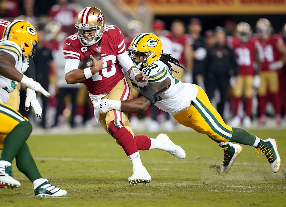 SANTA CLARA, CALIFORNIA - NOVEMBER 24:  Quarterback Jimmy Garoppolo #10 of the San Francisco 49ers is chased by outside linebacker Za'Darius Smith #55 of the Green Bay Packers during the first quarter of the game at Levi's Stadium on November 24, 2019 in Santa Clara, California. (Photo by Thearon W. Henderson/Getty Images)