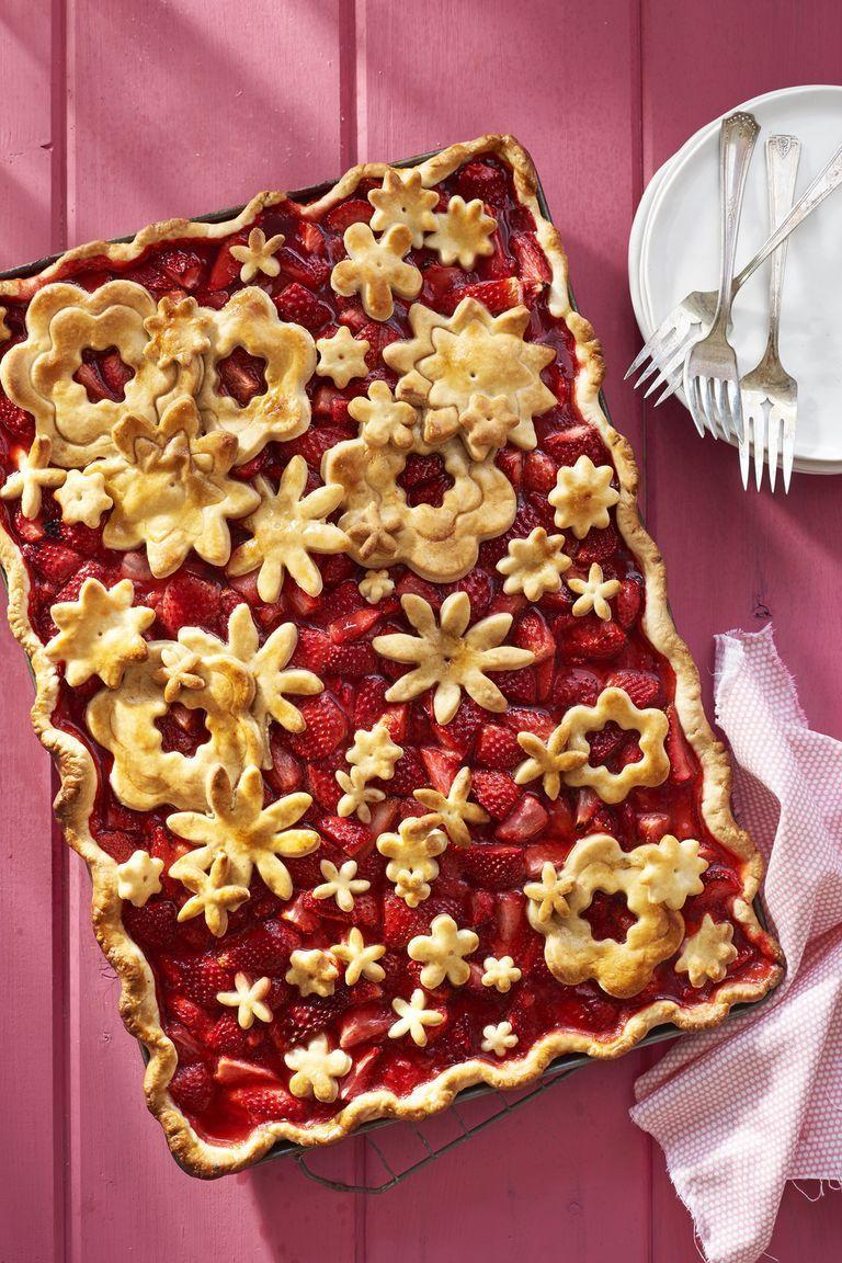 """<p>Delicious pastry flower cutouts make it a work of art.</p><p><em>Get the recipe from <a href=""""https://www.countryliving.com/food-drinks/recipes/a41978/strawberry-slab-pie-recipe/"""" rel=""""nofollow noopener"""" target=""""_blank"""" data-ylk=""""slk:Country Living"""" class=""""link rapid-noclick-resp"""">Country Living</a>.</em></p>"""
