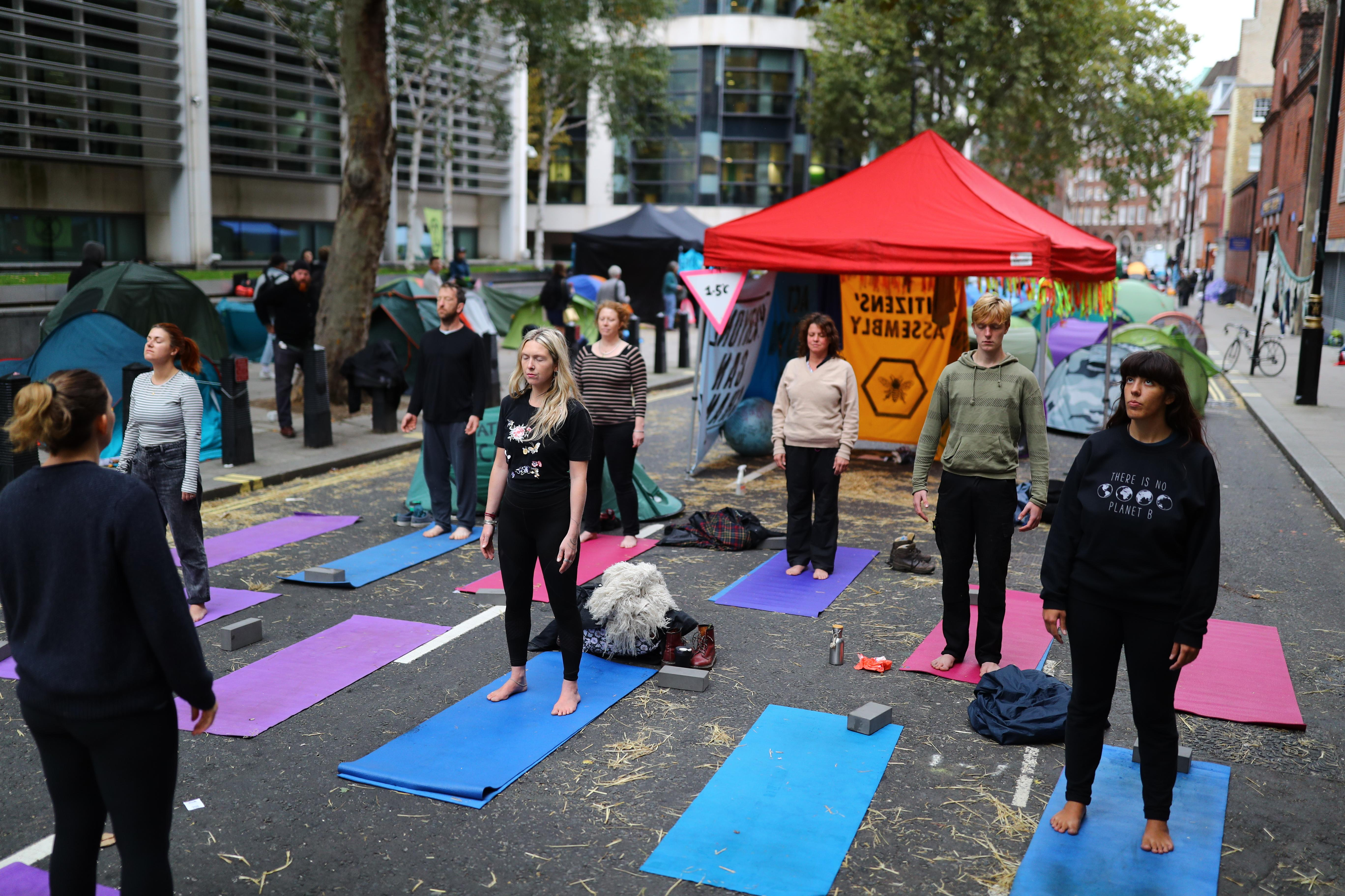 Early morning yoga at the Extinction Rebellion camp in Marsham Street, Westminster, London.