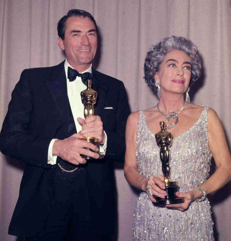 Gregory Peck and Joan Crawford backstage at the Oscars.