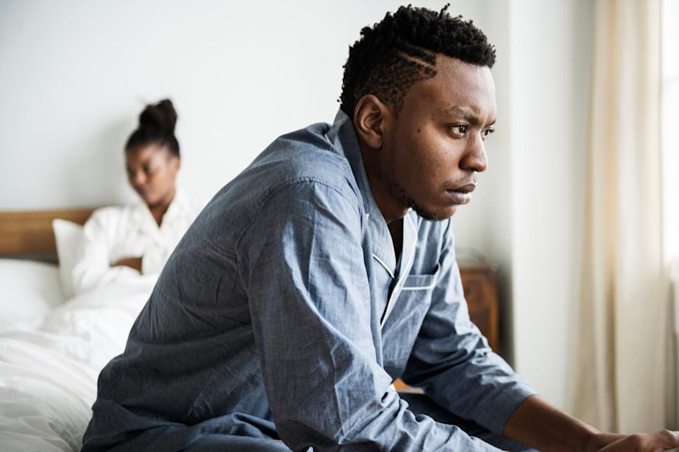 man and woman arguing in bed, things you should never say to your spouse