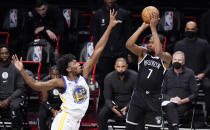 Golden State Warriors center James Wiseman (33) defends as Brooklyn Nets forward Kevin Durant (7) looks to shoot during the first quarter of an opening night NBA basketball game, Tuesday, Dec. 22, 2020, in New York. (AP Photo/Kathy Willens)