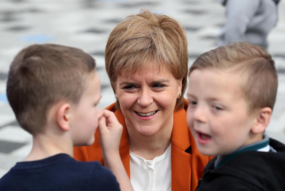 Free wraparound childcare for the lowest income families will help parents return to work, training or studies, Nicola Sturgeon said (Andrew Milligan/PA)