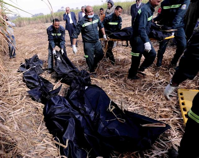 Egyptian rescue workers carry the dead bodies of foreign tourists, near the scene of a balloon crash outside al-Dhabaa village, just west of the city of Luxor, 510 kilometers (320 miles) south of Cairo, Egypt, Tuesday, Feb. 26, 2013. A hot air balloon flying over Egypt's ancient city of Luxor caught fire and crashed into a sugar cane field on Tuesday, killing at least 18 foreign tourists, a security official said. The casualties included French, British, Belgian, Hungarian, Japanese nationals and nine tourists from Hong Kong, Luxor Governor Ezzat Saad told reporters. (AP Photo/Ibrahim Zayed)