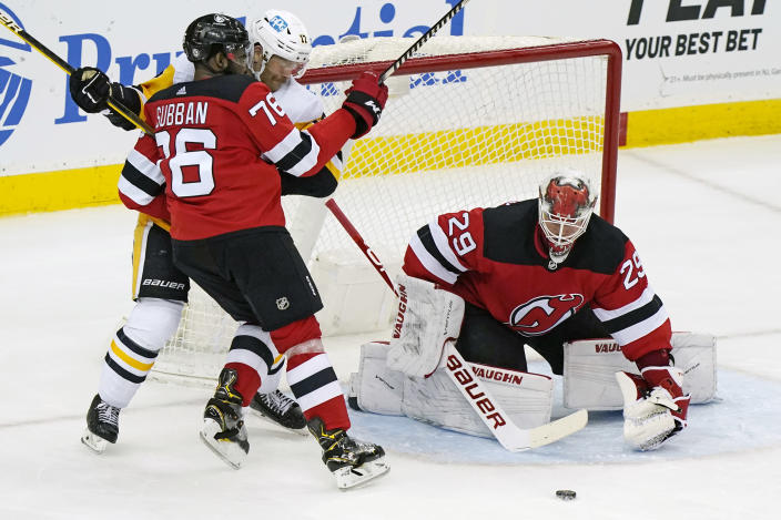 New Jersey Devils goaltender Mackenzie Blackwood (29) makes a save with New Jersey Devils defenseman P.K. Subban (76) fending off Penguins right wing Bryan Rust (17in front of the crease during the second period of an NHL hockey game, Sunday, April 11, 2021, in Newark, N.J. (AP Photo/Kathy Willens)