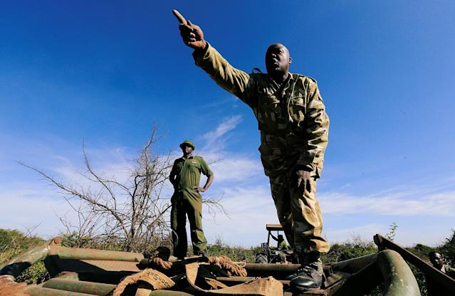 <p>Kenya Wildlife Service (KWS) rangers prepare to load a tranquillized elephant during a translocation exercise to Ithumba Camp in Tsavo East National Park, in Solio ranch in Nyeri County, Kenya, Feb. 21, 2018. (Photo: Thomas Mukoya/Reuters) </p>