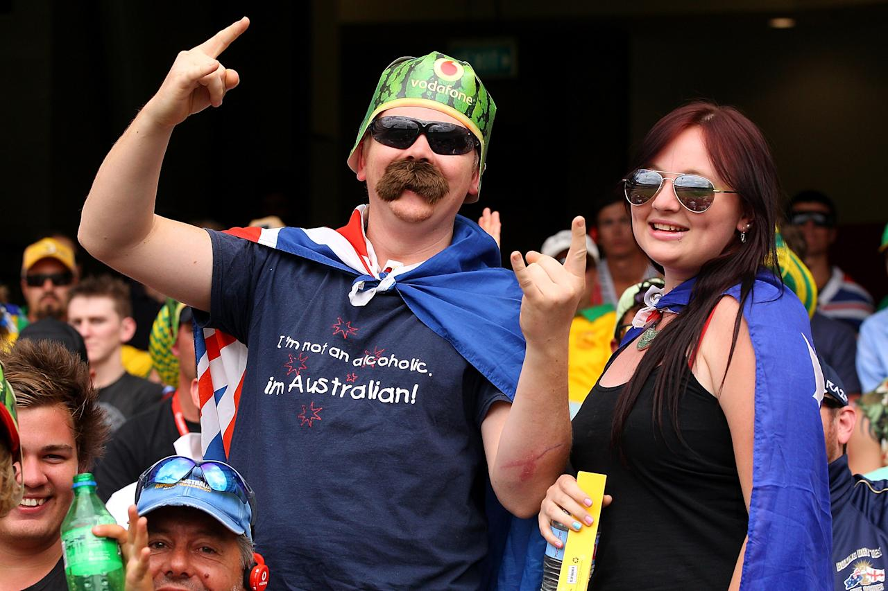 BRISBANE, AUSTRALIA - NOVEMBER 11:  Australian fans cheer during day three of the First Test match between Australia and South Africa at The Gabba on November 11, 2012 in Brisbane, Australia.  (Photo by Chris Hyde/Getty Images)