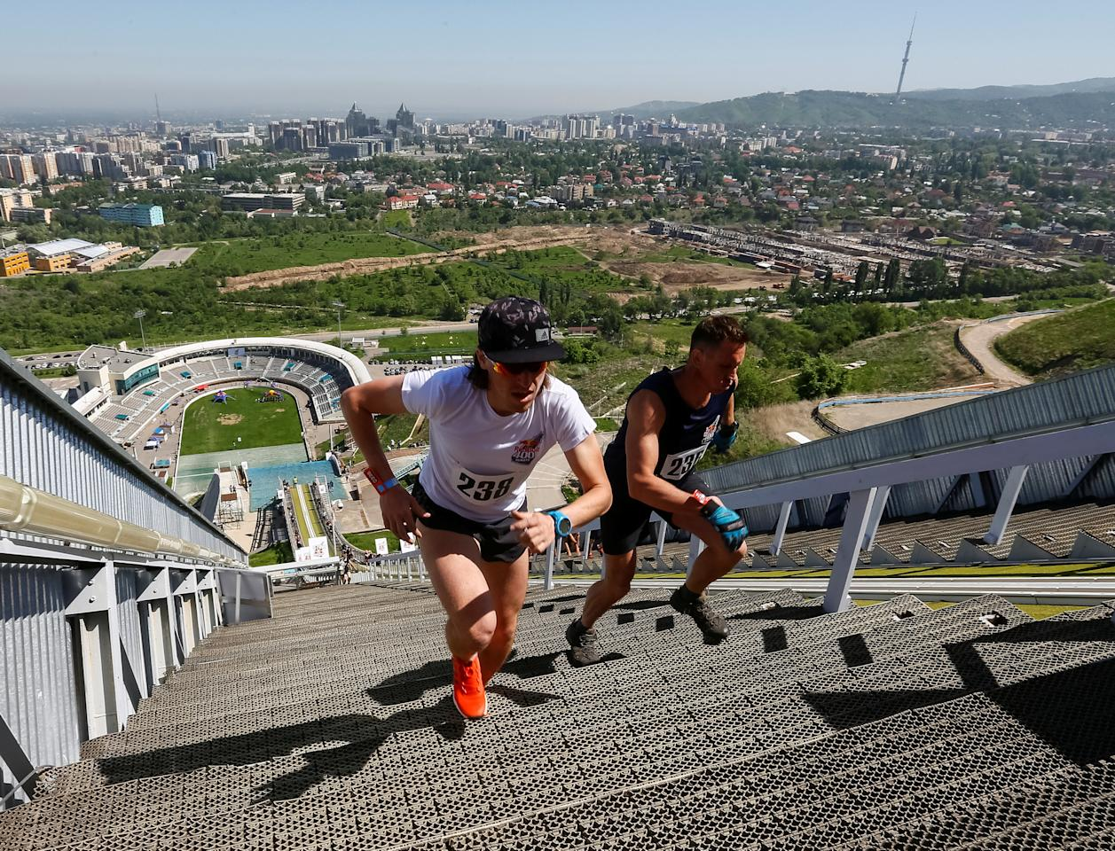 Athletes compete during the Red Bull 400 uphill sprint at the Sunkar International Ski Jumping Complex in Almaty, Kazakhstan, May 14, 2017.  REUTERS/Shamil Zhumatov
