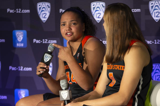 Oregon State's Destiny Slocum, left, and Mikayla Pivec answers reporters' questions during the Pac-12 Conference women's NCAA college basketball media day, Monday, Oct. 7, 2019, in San Francisco. (AP Photo/D. Ross Cameron)