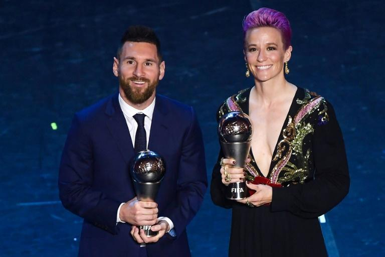 Lionel Messi (L) and Megan Rapinoe at FIFA's Best awards in 2019 (AFP Photo/Marco Bertorello)