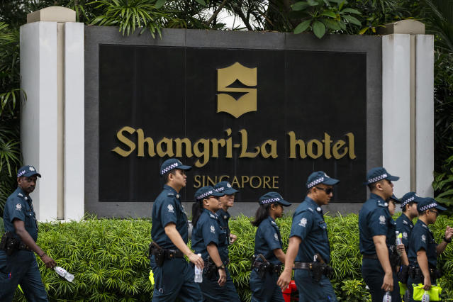 <p>Police officers patrol outside the Shangri-La Hotel in Singapore, Sunday, June 10, 2018, ahead of the summit between President Donald Trump and North Korean leader Kim Jong Un. (AP Photo/Yong Teck Lim) </p>