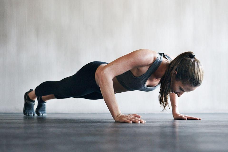 """<p>""""If there is one movement, I have seen a lot of women skip, it is a push up. We have just as much to gain as men do from push-ups. Lat activation, core stability, triceps definition, are just a few of the great benefits,"""" says <strong>c</strong><strong>ertified personal trainer and <a href=""""https://goldsamp.com/"""" rel=""""nofollow noopener"""" target=""""_blank"""" data-ylk=""""slk:Gold's AMP coach"""" class=""""link rapid-noclick-resp"""">Gold's AMP coach </a>Ally McKinney</strong>.</p><p><strong>How to: </strong>Start in a plank position with hands stacked under your shoulders, abs squeezed tight, and glutes engaged. Lower your chest and quads to the ground, making sure that your elbows are tracking behind you and not flaring out wide to engage the lats and protect the shoulders from injury. Once your chest and quads touch the ground, push back up into a plank position. Modify by lowering your knees to the ground and performing a knee push up, just be sure that your hips are staying flat and still ensuring that your chest and quads touch the ground.</p>"""