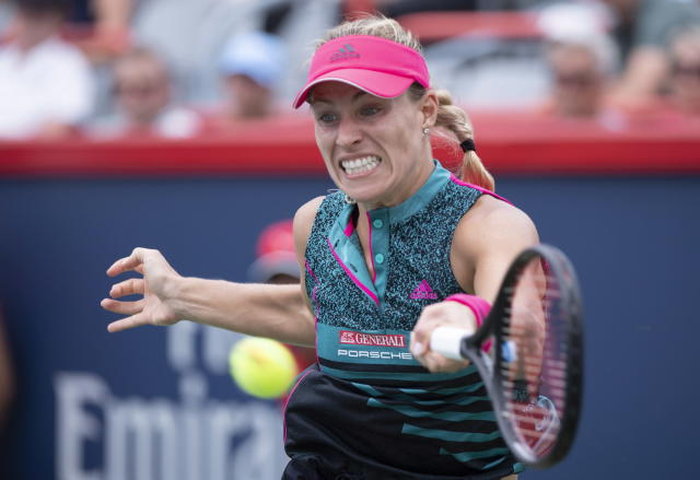 Angelique Kerber, of Germany, returns to Elize Cornet, of France, at the Rogers Cup women's tennis tournament, Wednesday, Aug. 8, 2018, in Montreal. (Paul Chiasson/The Canadian Press via AP)