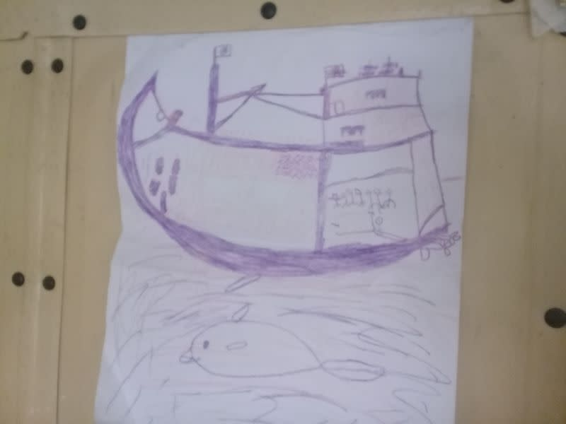 A drawing by a surviving Rohingya refugee child depicting his two months at sea on a wooden trawler en route to Malaysia, is seen in Cox's Bazar