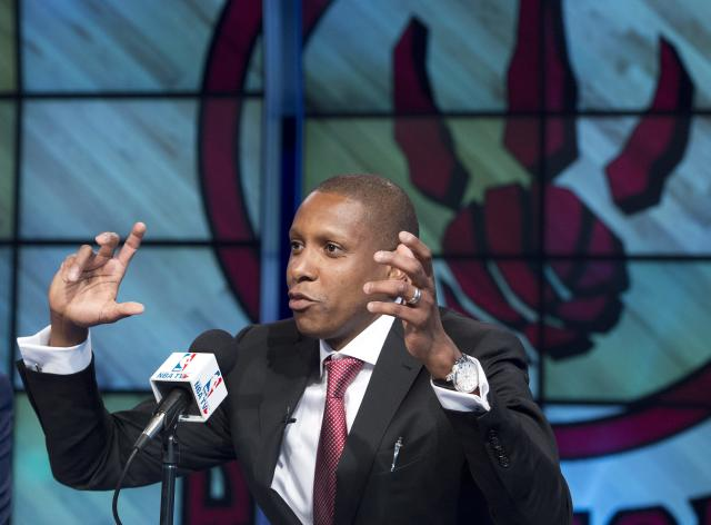 FILE - In this June 4, 2013, file photo, Toronto Raptors new general manager Masai Ujiri gestures during an NBA basketball news conference in Toronto. Raptors general manager Ujiri let loose a profanity during a pregame address meant to pump up a group of Raptors fans outside Air Canada Centre before a Saturday, April 19, 2014, opening game of the NBA playoffs. (AP Photo/The Canadian Press, Nathan Denette, File)