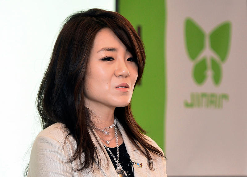 FILE - In this June 27, 2014 file photo, Korean Air senior Vice President Cho Hyun-min, also known as Emily Cho, speaks during a press conference in Seoul, South Korea. Korean Air Lines said Monday, April 23, 2018, that two daughters of its chairman will resign from their executive positions amid mounting public criticism over the women's behavior and the family's smuggling allegations. (Kang Jin-hyung/Newsis via AP, File)