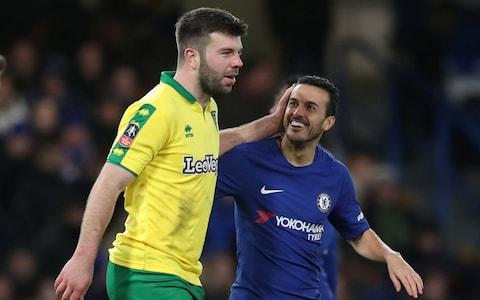 Chelsea's Pedro speaks with Norwich City's Grant Hanley - Credit: Action Images via Reuters