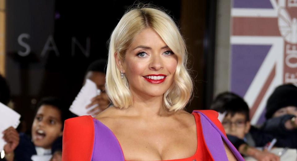 Holly Willoughby marked her sister Kelly's birthday with a throwback snap of the pair sharing a drink. (Getty Images)